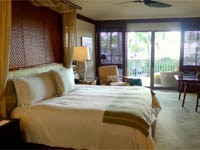Mid-20th-century Hawaiian-style guest rooms with natural woods and neutral color palette