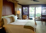 A guest room at Four Seasons Resort Hualalai at Historic Ka'upulehu
