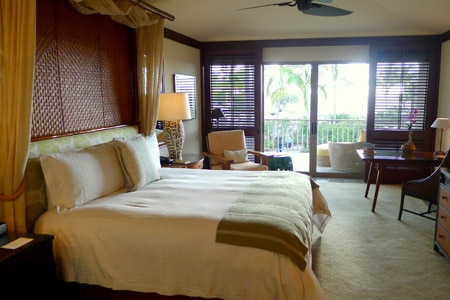 Mid-20th-century Hawaiian-style guest rooms with natural woods and neutral color palette at Four Seasons Hualalai at Historic Ka'upulehu in Hawaii