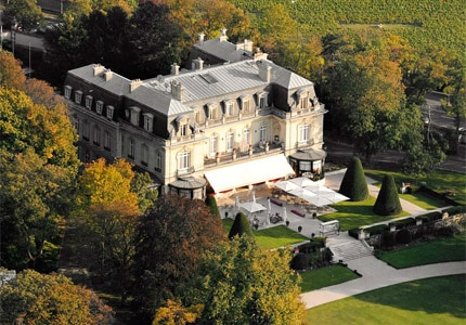 An aerial view of the historic Château Les Crayères in Reims