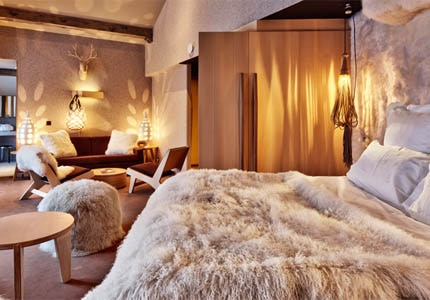 A guest room at Altapura in Val Thorens, France, one of GAYOT's Top 10 Hotels in France