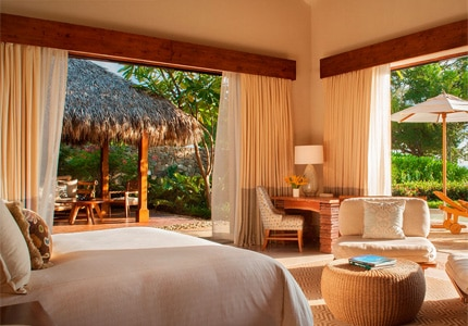 A guest room at Mukul Beach, Golf & Resort