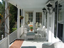The sunshine-filled porch at the Homestead Inn is perfect for daytime relaxation at A luxe chamber at Thomas Henkelmann - Homestead Inn in Greenwich, Connecticut