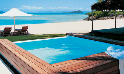 A pool overlooking the beach at the Hayman Resort on Hayman Island, Australia