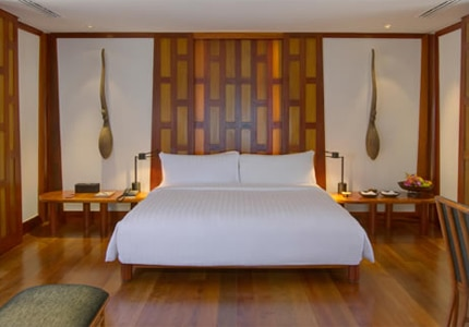 A guest room at Amanpuri in Phuket, Thailand, one of GAYOT's Top 10 Honeymoon Hotels Worldwide