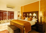 One of the nine lavishly appointed suites at Mihir Garh in Rajasthan, India