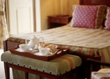Suite with complimentary breakfast tray at As Janelas Verdes
