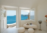 A suite with a sea view at Mystique, Santorini