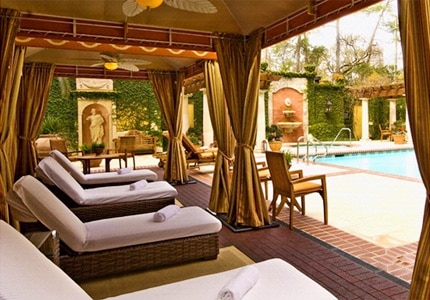 Lounge and unwind by the sparkling pool at Hotel Granduca, one of GAYOT's Top 10 Spa Hotels in Houston, Texas