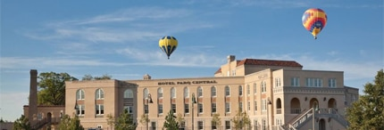 Hot air balloons fly over Hotel Parq Central in Albuquerque, NM