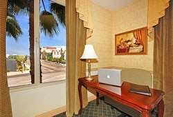 The desk area of a guest room at the Ayres Hotel Anaheim
