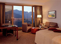 A deluxe guestroom with a mountain view