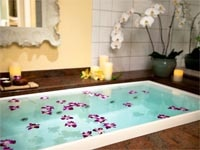 An infinity edge bath in The Kahala Spa at The Kahala Hotel & Resort in Honolulu, Hawaii