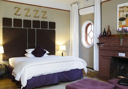 A king guest room at Mauger Estate Bed & Breakfast Inn, one of GAYOT's Top 10 Boutique Hotels in Albuquerque, NM