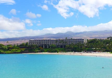The Mauna Kea Beach Hotel, one of GAYOT's Top 10 Golf Hotels in Hawaii, overlooks the Pacific Ocean off of the Kohala Coast on Hawaii's Big Island