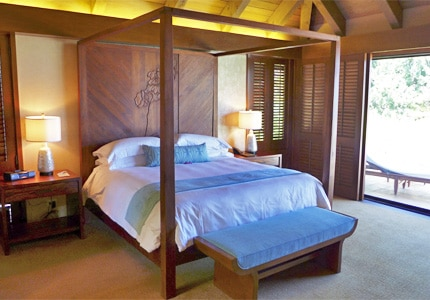 A guest room at Mauna Lani Bay Hotel & Bungalows, one of GAYOT'S top-rated hotels in Hawaii