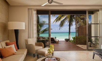 A suite living room with a view at Rosewood Mayakobá in Riviera Maya