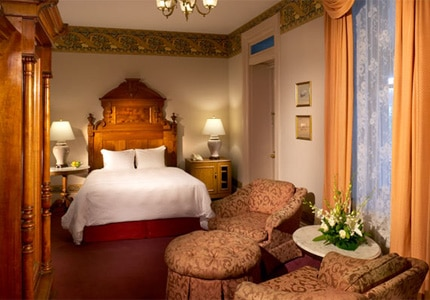 A Victorian guest room at Morrison-Clark Historic Inn & Restaurant, one of GAYOT's Top 10 Value Hotels in Washington, D.C.