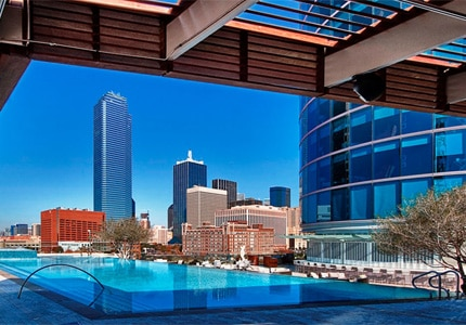 The heated rooftop pool is open all year at Omni Dallas Hotel, one of GAYOT's Top 10 Family Hotels in Dallas/Fort Worth, Texas