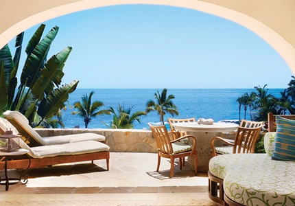 A junior suite's beachfront patio at One&Only Palmilla, one of GAYOT's top hotels in Los Cabos, Mexico