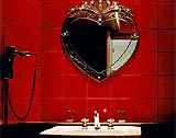 A heart shaped mirror at the Hôtel du Petit Moulin in Paris