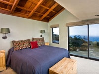 South Coast House bedroom with views of the ocean at Post Ranch Inn in Big Sur, California