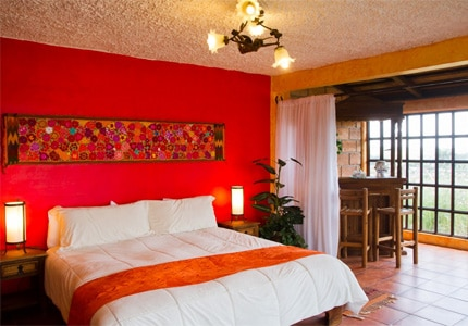 Rooms at Rancho Las Cascadas offer an authentic Mexican village feel
