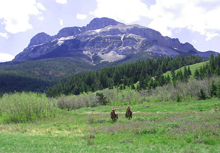 Horseback riding at Triple J Wilderness Ranch in Augusta, Montana, one of GAYOT's Top 10 Ranches Worldwide