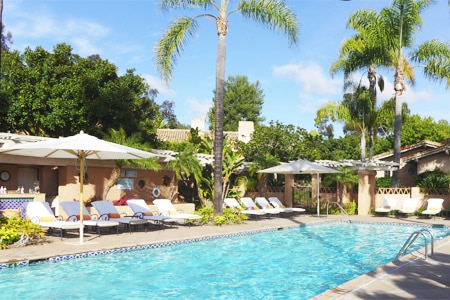 Relax by the pool on a beautiful Southern California day at Rancho Valencia, one of GAYOT's Top 10 Spa Hotels in San Diego, CA