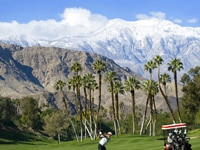 Enjoy mountain views and palm trees while golfing on the West Course at Omni Rancho Las Palmas in Rancho Mirage, California