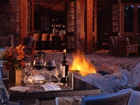 Outdoor dining with fire pit at bluEmber restaurant at Omni Rancho Las Palmas in Rancho Mirage, California