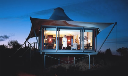 Each tent at Longitude 131 features private views of the sun rising and setting on Ayres Rock