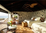 A guest room at Petit St. Vincent, The Grenadines
