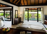 A room in a beach suite at Waldorf Astoria Maldives