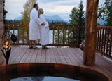 A couple enjoys the view from Winterlake Lodge in Alaska