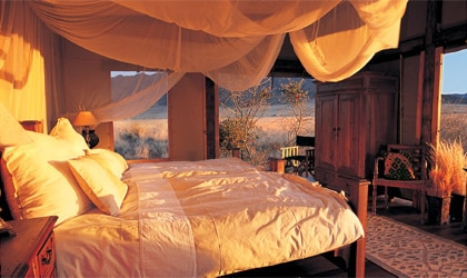 A bedroom at Wolwedans Private Camp in Namibia