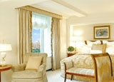 An elegant guestroom at The Ritz-Carlton New York, Central Park