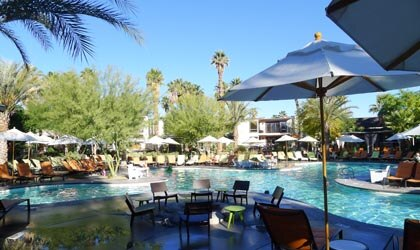 A pool with cabanas at Riviera Palm Springs in California