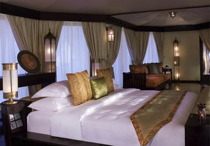 Guest room at Banyan Tree Al Wadi, one of GAYOT's Top 10 Romantic Hotels Worldwide