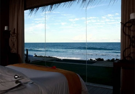 A guest room at Kenoa Exclusive Beach Spa & Resort, one of GAYOT's Top 10 Romantic Hotels Worldwide