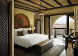 A guest room at Qasr Al Sarab Desert Resort by Anantara in Abu Dhabi