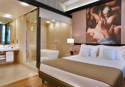 A guest room at Hotel Gran Melia Rome in Italy