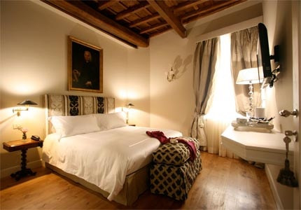 A guest room at Crossing Condotti in Rome