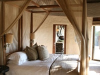 The master bedroom of the spacious suites of Singita Boulders Lodge on Sabi Sand Reserve, South Africa
