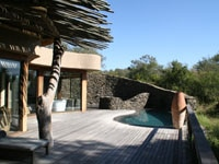 The pool deck of one of the spacious suites of Singita Boulders Lodge on Sabi Sand Reserve, South Africa