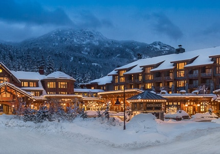 A snowy night at Nita Lake Lodge in Whistler, BC, one of GAYOT's Top 10 Ski Resorts Worldwide