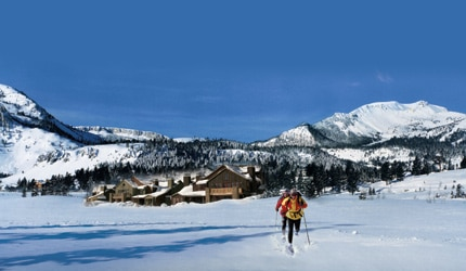 Cross-country skiers enjoy the winter weather outside Snowcreek Resort in Mammoth Lakes, California