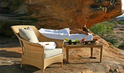 A woman relaxes outdoors at Bushmans Kloof in South Africa
