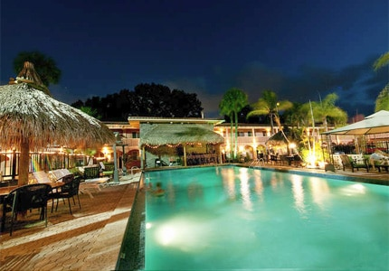 Go for a night swim at the heated pool of Tahitian Inn, one of GAYOT's Top 10 Value Hotels in Tampa Bay, Florida