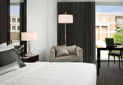 A guest room at The Lumen, A Kimpton Hotel, one of GAYOT's Top 10 Hip Hotels in Dallas/Fort Worth